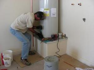 one of our Salinas water heater repair pros is installing a new unit